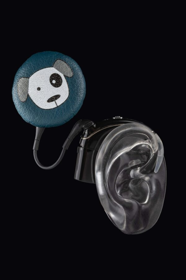 """cochlear implant coil hat design of """"Blue dog"""" in leather and to be used to cover the cochlear implant coil."""