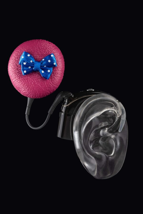 pink leather with blue bow cochlear implant coil hat from the Deafmetal USA collection to be used as cochlear implant accessory to personalize and make a cochlear implant unique to a child