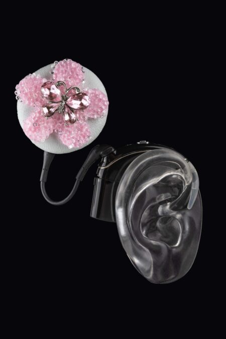 Pink flower coil hat from the Deafmetal USA collection of hearing aid and cochlear implant jewelry