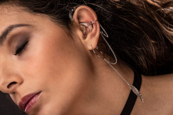 model wearing the Wings Deafmetal USA cochlear implant and hearing aid jewelry