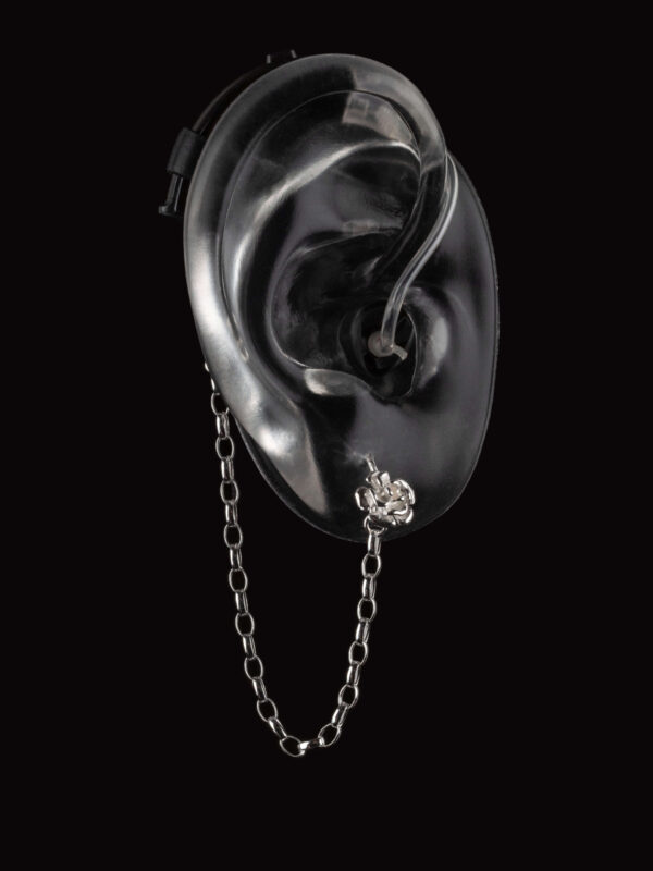 Silver Rose design of Deafmetal hearing aid or cochlear implant jewelry